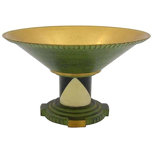A French Art Deco coupe of gilded and patinated metal, ebony wood, and celluloid, dating circa 1930.