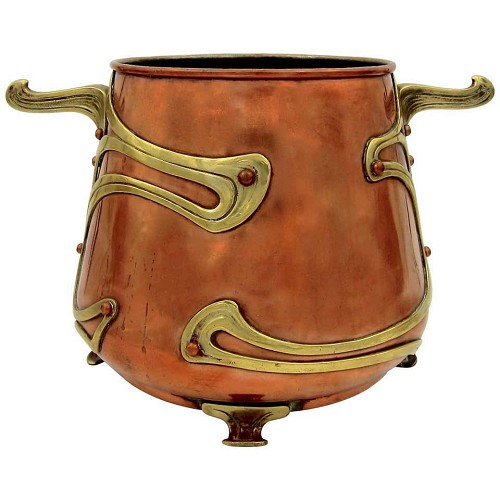 A large Continental jardiniere in copper with brass mounts, dating circa 1900.